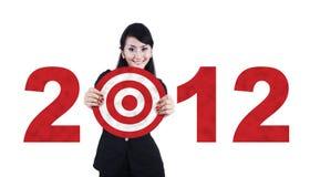 Aziatische bedrijfsvrouw met van bedrijfs 2012 doel stock foto's