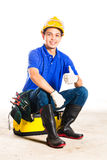 Aziatische bouwvakker met hulpmiddelen Stock Foto