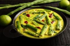 Aziatische cuisine- moringa mangokerrie, stock afbeeldingen