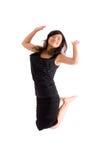 Aziatische geïsoleerde= tiener in zwarte rok Stock Foto's