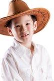 Aziatische Jongen die de Hoed van de Cowboy draagt Stock Afbeeldingen