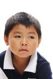 Aziatische Jongen die weg kijkt royalty-vrije stock foto's
