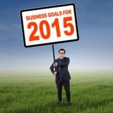 Aziatische manager met bedrijfsdoelstellingen voor 2015 Royalty-vrije Stock Foto's