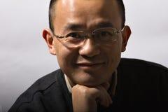 Aziatische medio-volwassen mens Royalty-vrije Stock Afbeeldingen