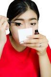 Aziatische meisjesmake-up royalty-vrije stock afbeeldingen