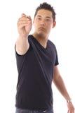 Aziatische mens die een pen houden royalty-vrije stock afbeeldingen
