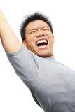 Aziatische mens die zijn opwinding gilt uit te drukken stock foto