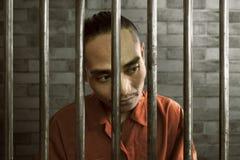 Aziatische mens in gevangenis royalty-vrije stock foto