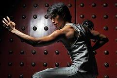 Aziatische Mens in het Bestrijden van Actie Royalty-vrije Stock Foto