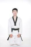 Aziatische mens het spelen taekwondo royalty-vrije stock afbeeldingen