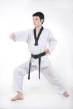 Aziatische mens het spelen taekwondo stock afbeelding