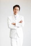 Aziatische mens in kostuum Neem foto in Studio royalty-vrije stock foto's