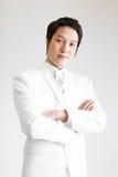 Aziatische mens in kostuum Neem foto in Studio royalty-vrije stock afbeeldingen