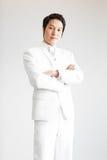 Aziatische mens in kostuum Neem foto in Studio royalty-vrije stock fotografie