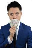 Aziatische mens met de mond van de gelddekking, nota royalty-vrije stock foto's