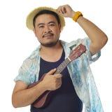 Aziatische mens met ukelele Stock Afbeelding