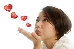 Aziatische mooie vrouw die kussen verzendt Royalty-vrije Stock Foto