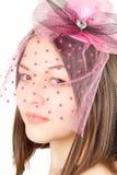Aziatische mooie vrouw in een roze hoed Royalty-vrije Stock Afbeeldingen