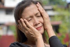 Aziatische Oma en Zwakzinnigheid stock fotografie