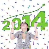 Aziatische onderneemster die een nieuw jaar 2014 vieren Royalty-vrije Stock Foto