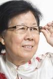 Aziatische Oude Dame Royalty-vrije Stock Afbeeldingen