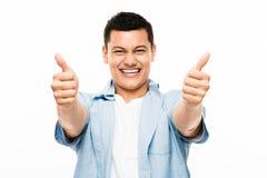 Aziatische student gelukkige duimen omhoog Stock Foto's