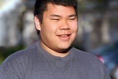 Aziatische tiener in openlucht Royalty-vrije Stock Afbeelding