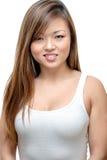 Aziatische Vrouw die in Wit glimlachen Stock Foto's