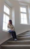 Aziatische vrouw door venster royalty-vrije stock foto
