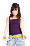 Aziatische vrouw met lege zakken Stock Fotografie