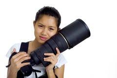 Aziatische vrouw met nok en tele Stock Foto's