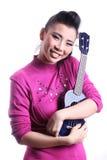 Aziatische vrouw met Ukelele Royalty-vrije Stock Afbeelding