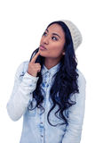 Aziatische vrouw met vinger op kin Stock Foto