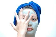 Aziatische vrouw op masker Stock Foto's