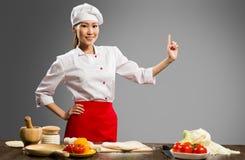 Aziatische vrouwelijke chef-kok Stock Foto