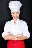 Aziatische vrouwelijke chef-kok in eenvormig chef-kokwit en hoed Royalty-vrije Stock Afbeelding