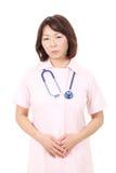 Aziatische vrouwelijke verpleegster Stock Afbeelding