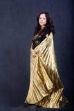 Aziatische vrouwen met gouden vleugels Stock Fotografie