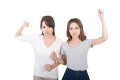 Aziatische vrouwenstrijd togethe stock foto's