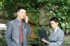 Aziatische zakenlieden stock afbeeldingen