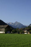 Azienda agricola alpina Immagine Stock