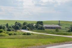 Azienda agricola e paesaggio di estate Fotografie Stock Libere da Diritti