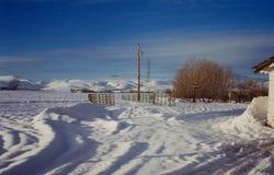 Azienda agricola innevata dell'Idaho su Sunny Day Immagine Stock Libera da Diritti