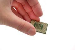 Azienda di trasformazione del computer tenuto in mano Immagine Stock