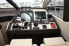 Azimut 55S captains wheel with navigation panel Royalty Free Stock Photo