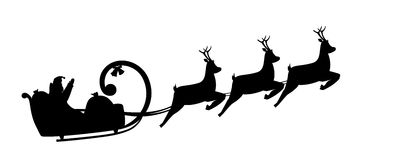 Azionamenti del Babbo Natale della siluetta in una slitta Fotografia Stock Libera da Diritti
