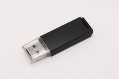 Azionamento dell'istantaneo del USB su priorità bassa bianca Fotografie Stock