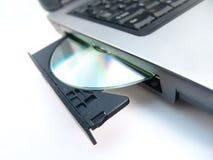 Azionamento di CD-ROM con CD Immagine Stock