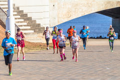 Azione della corsa maratona delle ragazze Fotografia Stock
