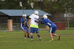 Azione di Lacrosse Fotografia Stock